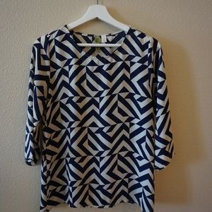 Navy blue and white patterned blouse